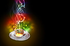 Mint tea. A cup of mint tea, celebrating the New Year in colorful fireworks exploding over black background royalty free stock photo