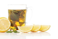 Mint tea and fresh lemons Royalty Free Stock Photos