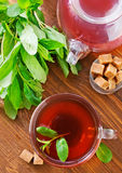 Mint tea. In glass cup and on a table stock photos