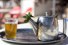 Mint tea in a glass and pot Stock Photo