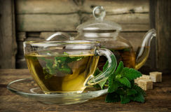 Mint tea in glass teapot and cup Royalty Free Stock Photography