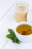 Mint tea with honey on wooden table. Royalty Free Stock Photo