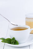 Mint tea with honey on wooden table. Stock Photo