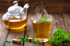 Mint tea. Hot mint herbal tea in glass cup royalty free stock photos