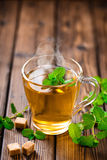 Mint tea. Hot mint herbal tea in glass cup stock photography