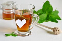Mint tea with mint leaves and honey Royalty Free Stock Photos