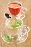 Mint tea and tea Hibiscus in glass cups Royalty Free Stock Photos