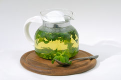 Mint tea in teapot Royalty Free Stock Images