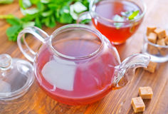 Mint tea. In teapot on a table royalty free stock photo