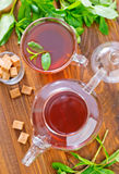 Mint tea. In teapot on a table royalty free stock photography