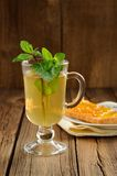 Mint tea and toasts with orange marmalade on wooden background Royalty Free Stock Photography