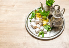 Mint tea with traditional arabic delight. Oriental hospitality Stock Photo