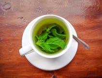 Mint tea cup on the wood table Stock Photos