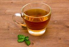 Mint tea on wood Stock Images