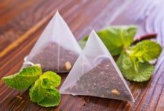 Mint tea. On the wooden table, fresh tea royalty free stock image