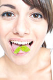 Mint on tongue Royalty Free Stock Image