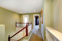 Mint upstairs hallway with white railings Stock Photography