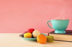 Mint vintage cup of coffee and colorful macaron Royalty Free Stock Photography