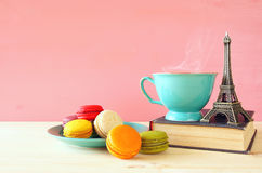 Mint vintage cup of coffee and colorful macaron Stock Photos