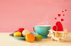Mint vintage cup of coffee and colorful macaron Stock Images