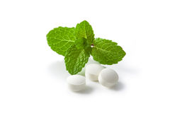Mint and white pills Stock Photos