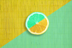 Mint and yellow colors citrus lemon slice on mint and yellow bamboo texture Stock Photo