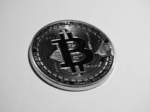Minted bitcoin. A physical bitcoin in black and white image Royalty Free Stock Photography