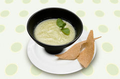 Minty soup. Minty cold soup in a black bowl with croutons Stock Photography