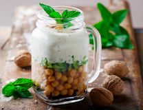 Minty yogurt parfaits in the jar.style rustic. Selective focus Stock Photo