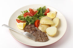 Minuite steak and salad Stock Photography