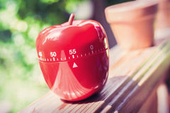 55 Minute Kitchen Egg Timer in Apple Shape Standing On A Handrail Stock Photography