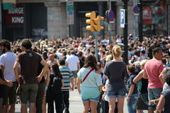 Minute of silence for the Barcelona victims. BARCELONA/SPAIN - 18 AUGUST 2017: Crowd attending the minute of silence for the at least 14 deadly victims and over Royalty Free Stock Photos