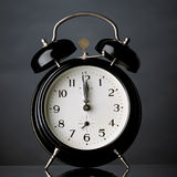 Minute to midnight. Black alarm clock stock photo