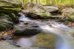 Minute waterfall. Beautiful scene of creek waterfall in summertime Stock Photography