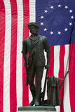 Minuteman Statue and US Flag Royalty Free Stock Images