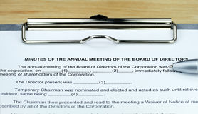 Minutes Of The AGM. A ball point pen placed on a form for taking the Board minutes, in preparation for the meeting Royalty Free Stock Photo