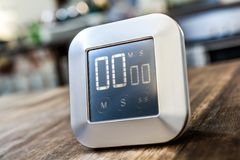 0 Minutes - Digital Chrome Kitchen Timer On Wooden Table Royalty Free Stock Photography