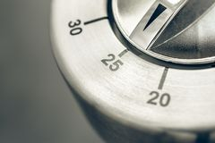 25 Minutes - Macro Of An Analog Chrome Kitchen Timer On Wooden Table Stock Images