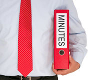 Minutes - Manager holding red binder with text. On white background Stock Photo