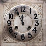 Minutes to midnight. Shot of old clock showing 5 minutes to midnight Royalty Free Stock Images