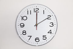 10 minutes after 12. On a wall clock Royalty Free Stock Images