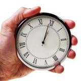 Minuto a la medianoche o mediodía en el reloj retro. Imágenes de archivo libres de regalías