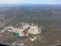 Minvillebråd för öppen grop från luften Arkivfoto