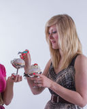Minx. Two cheerful girls with desert. Stock Photography