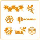 Miodowi pszczoła logowie Zdjęcia Stock