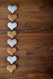 Miodowniki na drewnianym kuchennym kontuarze Fotografia Stock