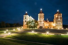 Mir, Belarus. Mir Castle Complex In Evening Illumination Lightin. G. Famous Landmark, Ancient Gothic Monument Of Feudalism Under Blue Night Sky. UNESCO Heritage royalty free stock image