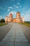 Mir, Belarus. Mir Castle Complex On Blue Sunny Sunset Sky Backgr Stock Image