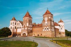 Mir, Belarus. Mir Castle Complex On Blue Sunny Sunset Sky Backgr Stock Photo