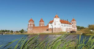 Mir, Belarus. Mir Castle Complex From Side Of Lake. UNESCO World Heritage Site. Famous Landmark In Summer Sunny Day stock video